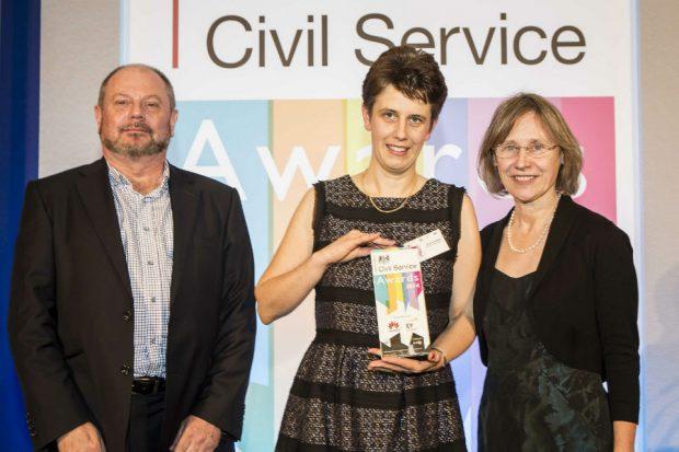 Three people with civil service award